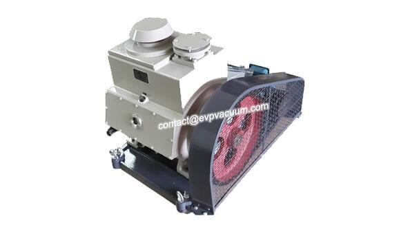 Rotary vane vacuum pump in solvent-free liner