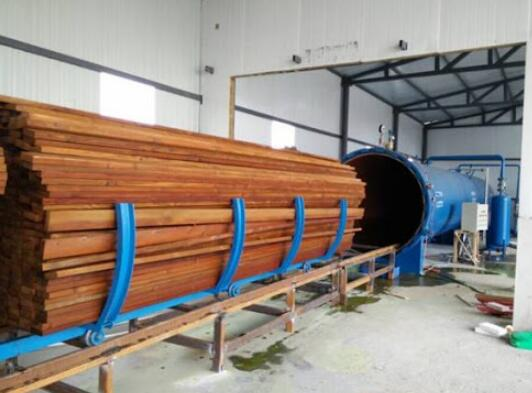 Load the wood into a vacuum pressurized tank
